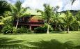 Rommene på hotellet ligger i småhus i dette fantastiske hageanlegget