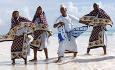 Tradisjonell dans på stranden