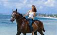 Hesteridning langs stranden